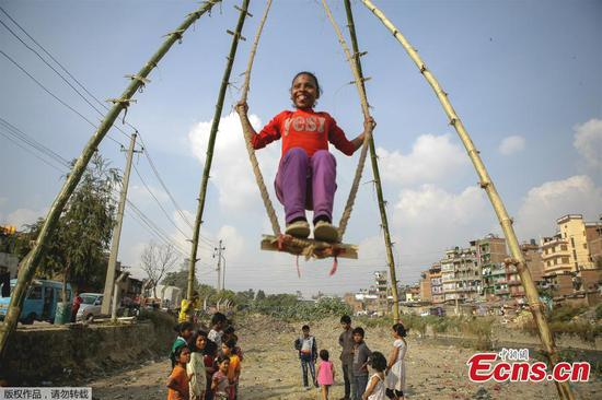 Nepali children having fun with Dashain Ping swing