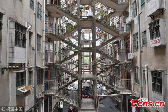 Buildings connected by shared stairs