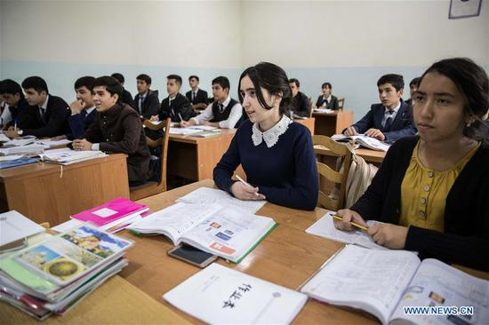 Students take Chinese language lesson at the Confucius Institute of the Tajik National University for Nationalities in Dushanbe, Tajikistan, on Oct. 10, 2018. (Xinhua/Wu Zhuang)