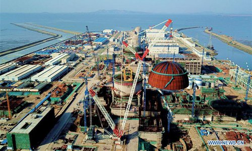 Photo taken on March 21, 2018 shows the installation site of a hemispherical dome at the No. 6 unit of China National Nuclear Corporation's Fuqing nuclear power plant in Southeast China's Fujian Province. In May 2017, a containment dome was installed on the No. 5 unit of the nuclear power plant, the first reactor featuring the Hualong One design. (Photo/Xinhua)