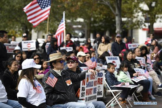 People demonstrate at the Copley Square in Boston, the United States, on Oct. 14, 2018.  (Xinhua/Liu Jie)