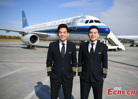 Twin brothers realize childhood dream of becoming pilots