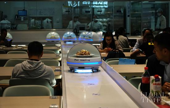 Robots are ready to serve visitors at the China International Import Expo