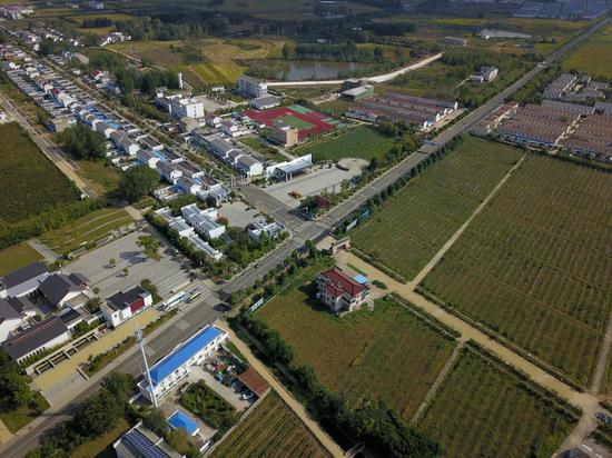 Aerial view of Xiaogang, Anhui province. The village, birthplace of China's rural reform, was at a crossroad in 1978 when the collectivized farming policy had been in force nationwide for about 20 years. (Photo by Zhu Lixin/chinadaily.com.cn)