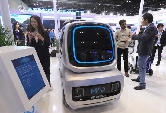 A self-driving delivery vehicle on display at the World Intelligent Connected Vehicles Conference in Beijing. (Photo by Cheng Gong / for China Daily)