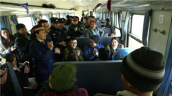 A scene from the first episode of the CCTV documentary The Slow Train Home shows passengers and crew on board the No 5633 train on the Chengdu-Kunming route. (Photo provided to China Daily)