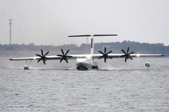 The AG600, codenamed Kunlong, slides on the water surface of a reservoir near Zhanghe Airport in Jingmen, central China's Hubei Province, on Oct. 20, 2018. China's independently-developed large amphibious aircraft AG600 completed its first water takeoff and landing in Jingmen on Saturday morning. (Xinhua/Cheng Min)