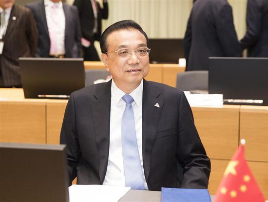 On Eurasian trip, Li calls for safeguarding free trade