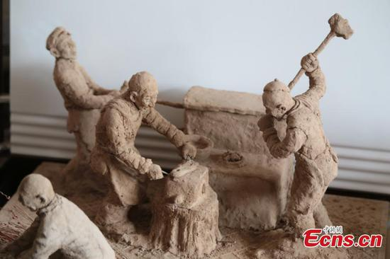 Clay sculpture reveals rugged countryside life in the past