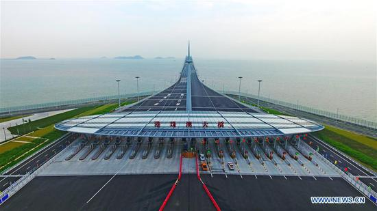 Aerial photo taken on Oct. 24, 2018 shows the toll gate of the Hong Kong-Zhuhai-Macao Bridge in Zhuhai, south China's Guangdong Province. The bridge officially opened to traffic at 9 a.m. on Oct. 24. (Xinhua/Liang Xu)