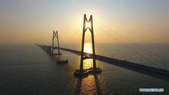 The Hong Kong-Zhuhai-Macao Bridge is seen in the morning sunshine, Dec. 27, 2017.(Xinhua/Liang Xu)