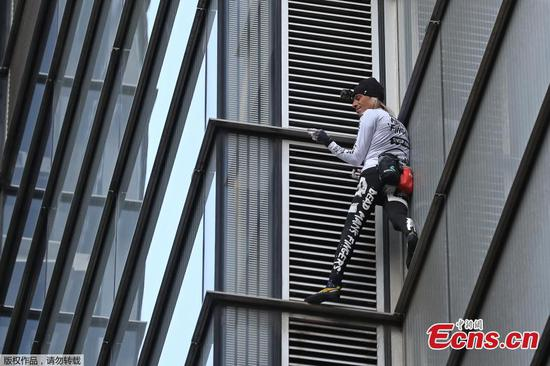 French spiderman scales London's Heron Tower