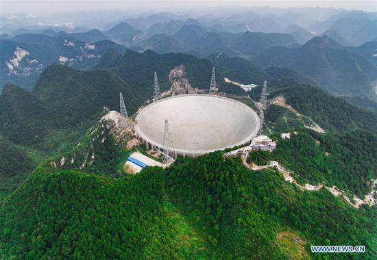 Photo taken on Sept. 15, 2016 shows the Five-hundred-meter Aperture Spherical Telescope (FAST) in Pingtang County, southwest China's Guizhou Province. (Photo/China News Service)