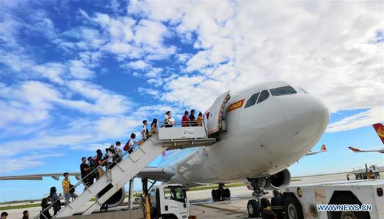 Chinese tourists get on board to fly back home in Saipan, the Commonwealth of the Northern Mariana Islands (CNMI), Oct. 28, 2018. (Xinhua)