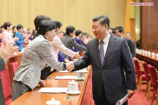 Chinese President Xi Jinping, also general secretary of the Communist Party of China (CPC) Central Committee and chairman of the Central Military Commission, shakes hands with delegates to the 12th National Women's Congress (NWC) in Beijing, capital of China, Oct. 30, 2018. (Photo/Xinhua)