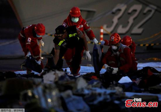 Rescue workers of the crashed Lion Air flight JT610 sort out newly recovered debris at Tanjung Priok port in Jakarta, Indonesia, Oct. 30, 2018. The search continued Tuesday for bodies and the