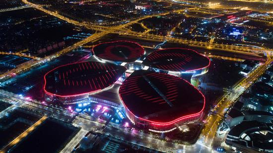 Aerial photo taken on Oct. 21, 2018 shows a night view of the National Exhibition and Convention Center (Shanghai), the main venue to hold the upcoming first China International Import Expo (CIIE), in Shanghai, east China. (Xinhua/Ding Ting)