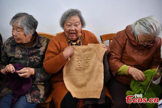 Knitting sweaters to help children
