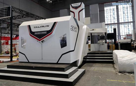 A Taurus milling machine from German Waldrich Coburg is adjusted at the National Exhibition and Convention Center in Shanghai, east China, on Oct. 30, 2018. (Xinhua/Fang Zhe)