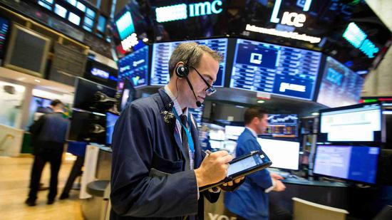 U. S. stocks close higher as investors await midterm election results