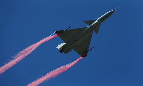 J-10B fighter jets hone combat skills for night air refueling, extending range