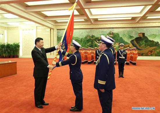 Chinese President Xi Jinping, also general secretary of the Communist Party of China (CPC) Central Committee and chairman of the Central Military Commission, confers the flag to the China National Comprehensive Fire and Rescue Team during a flag-conferring ceremony held at the Great Hall of the People in Beijing, capital of China, on Nov. 9, 2018. (Xinhua/Wang Ye)