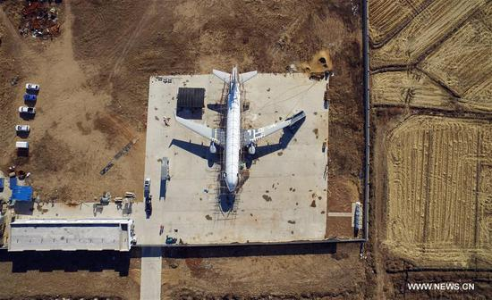 Villager builds full size plane model in Liaoning