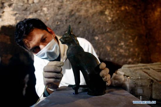 Egypt unearths 7 pharaonic tombs near capital Cairo