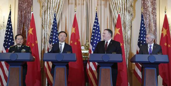 Senior officials meet with reporters after the second China-US Diplomatic and Security Dialogue in Washington on Friday. (LIU JIE/XINHUA)