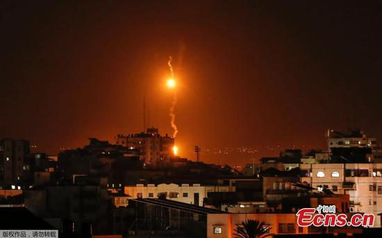 Israel faces intense rocket fire from Gaza as Hamas retaliates for botched commando raid