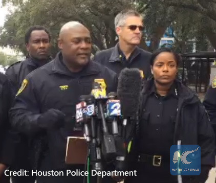 Teenager shot dead near Houston school, suspects at large