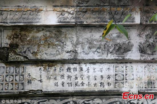 Ancient poetry and paintings found on residential building in Jiangxi