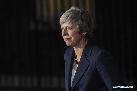 British Prime Minister Theresa May delivers a Brexit statement outside 10 Downing Street in London, Britain, on Nov. 14, 2018. Theresa May announced Wednesday night that the cabinet has given its backing to her Brexit deal. (Xinhua/Stephen Chung)
