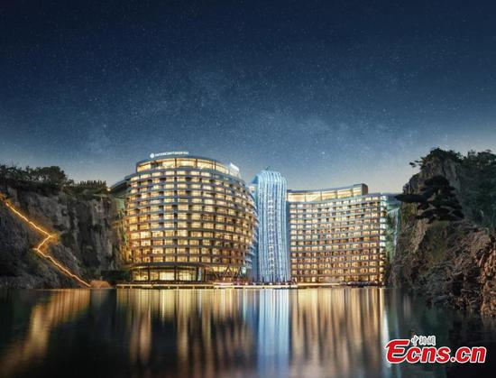 Luxury underground hotel in China offers rooms submerged in aquarium