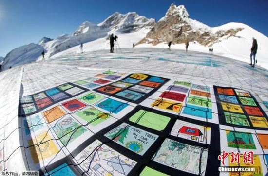 Giant postcard unveiled to fight climate change in Switzerland