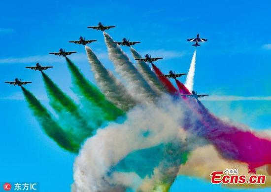 Italian Air Force aerobatic team performs over Kuwait City