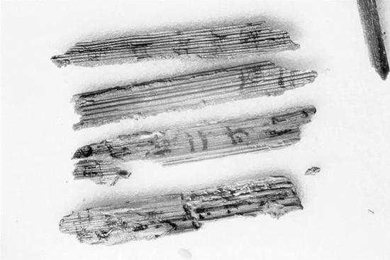 Bamboo slips unearthed in ancient tomb in Shanxi