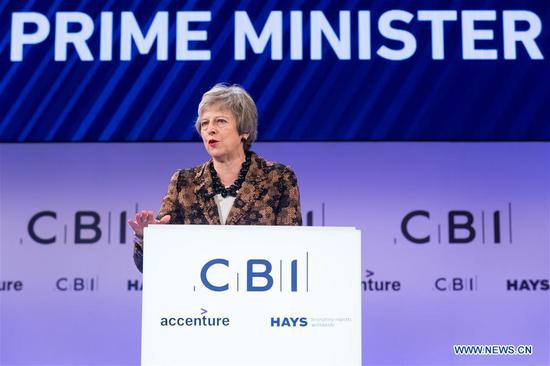 British Prime Minister Theresa May delivers a keynote speech at the annual conference of the Confederation of British Industry (CBI) in London, Britain, on Nov. 19, 2018. Theresa May on Monday enlisted British business leaders to back her much-criticized Brexit deal, insisting that she would not make any change to the draft divorce agreement between London and Brussels. (Xinhua/Ray Tang)