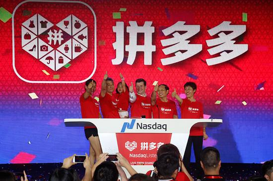 Company executives of Pinduoduo celebrate as the company gets listed on the Nasdaq on July 26. (Provided to China Daily)