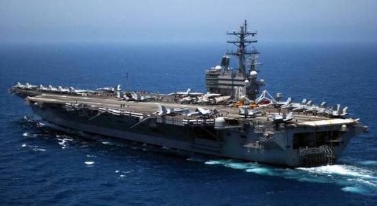 U.S. carrier port call sends positive signal