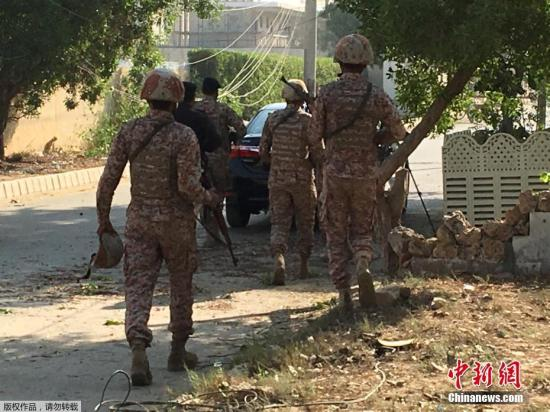 Pakistani police officers are seen near the Chinese embassy in Karachi, Pakistan November 23, 2018. (Photo/Agencies)