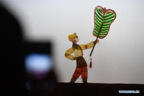 Pic story of shadow puppetry player in China's Zhejiang