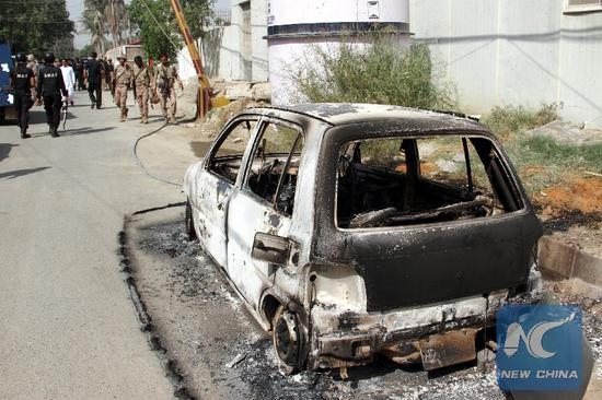 A burned out vehicle is seen at the attack site in Karachi, Pakistan, on Nov. 23, 2018. At least five people including two policemen were killed on Friday morning in a terrorist attack in the diplomatic area in Karachi, police and hospital officials said. (Xinhua/Stringer)