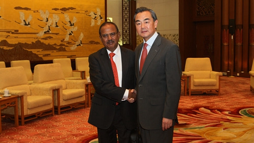 Chinese Foreign Minister Wang Yi meets with Special Envoy of Prime Minister of India and National Security Adviser Ajit Doval at the Great Hall of the People in Beijing, September 9, 2014. (Photo via Chinese Foreign Ministry)