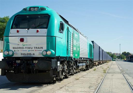 A freight train leaves for China's Yiwu City in Madrid, Spain, May 18, 2015. (Xinhua/Xie Haining)