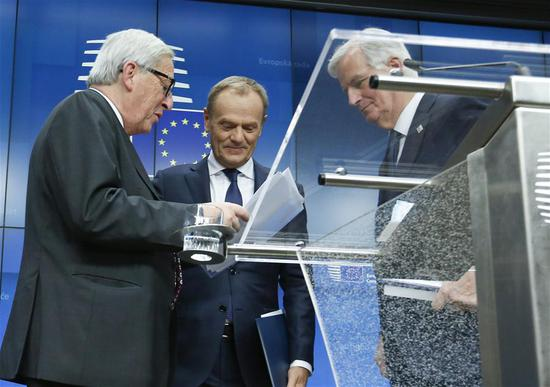 European Commission President Jean-Claude Juncker, President of the European Council Donald Tusk and the European Union's (EU) chief negotiator Michel Barnier (from L to R) talk after a press conference at the end of a special Brexit summit in Brussels, Belgium, Nov. 25, 2018.  (Photo/Xinhua)