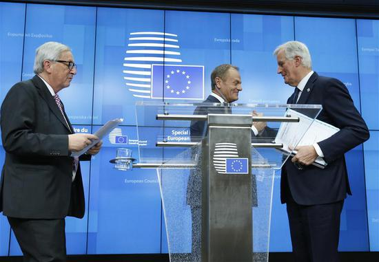 European Commission President Jean-Claude Juncker, President of the European Council Donald Tusk and the European Union's (EU) chief negotiator Michel Barnier (from L to R) greet each other after a press conference at the end of a special Brexit summit in Brussels, Belgium, Nov. 25, 2018.  (Photo/Xinhua)