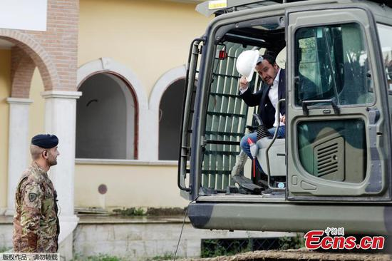 Italy's interior minister leads demolition of mafia villa