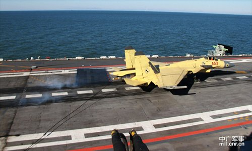 Photo shows carrier-borne J-15 fighter jet lands on China's first aircraft carrier, the Liaoning. (Photo/mil. cnr.cn)