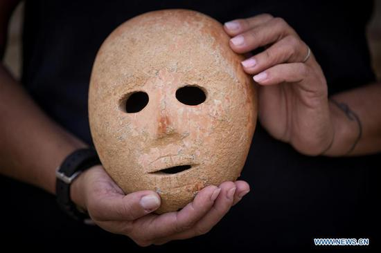 Israel discovers 9,000-year-old stone mask in southern West Bank